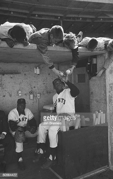 Giants baseball players Willie Mays and Willie McCovey in dugout of new Candlestick stadium