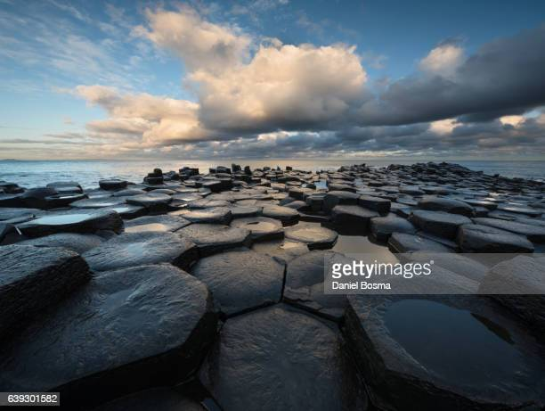 Giant's Causeway basalt columns with Atlantic Ocean in the distance