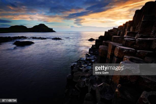 Giant's Causeway in Northern Ireland with sunset light on basalt columns, long exposure