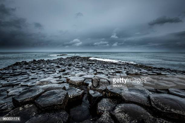 giants causeway, northern ireland - water's edge stock pictures, royalty-free photos & images