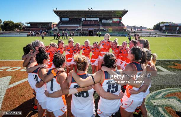 Giants celebrate victory during the 2020 AFLW Round 06 match between the Adelaide Crows and the GWS Giants at Hisense Stadium on March 15 2020 in...