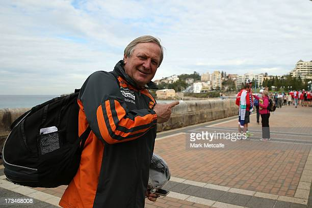 Giants coach Kevin Sheedy points towards Swans players during a Sydney Swans AFL recovery session at Coogee Beach on July 15 2013 in Sydney Australia