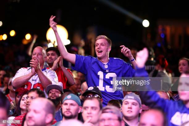 Giants fan cheers after Evan Engram of Ole Miss was picked overall by the New York Giants during the first round of the 2017 NFL Draft at the...