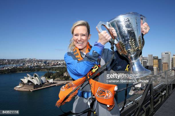 Giants fan Melissa Doyle poses with the AFL Premiership Cup on top of the Sydney Harbour Bridge on September 7 2017 in Sydney Australia