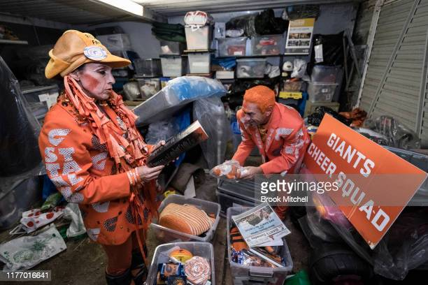 Giants fans Kath and Seb Dell'Orefice dig through mountains of Giants memorabilia in their garage before Saturday's 2019 AFL Grand Final on September...