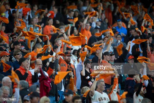 Giants fans swirl their rally towels during Game 2 of the National League Championship Series between the San Francisco Giants and the St Louis...
