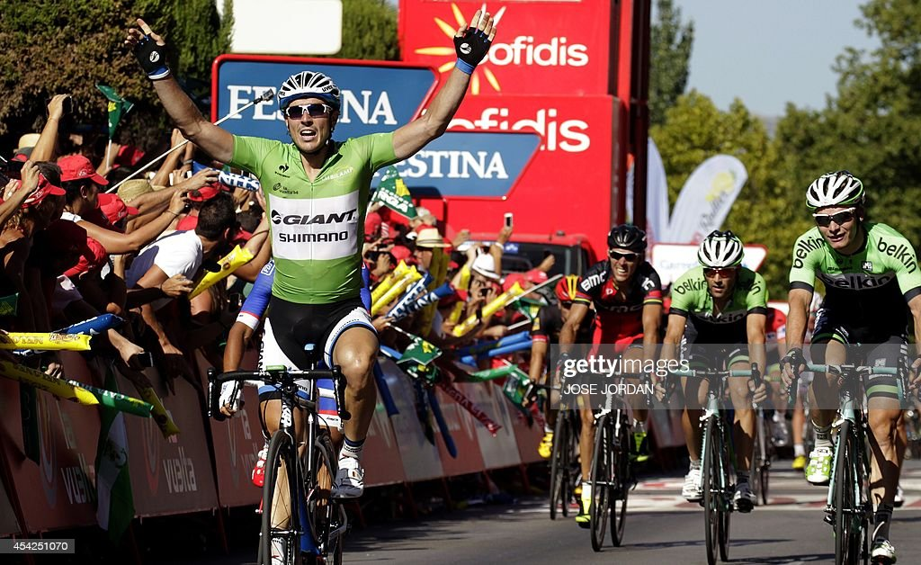 Giant's German rider John Degenkolb (L) celebrates as he crosses the finish line to win the 5th stage of the 69th edition of 'La Vuelta' Tour of Spain, a 180km ride from Priego de Cordoba to Ronda, on August 27, 2014.