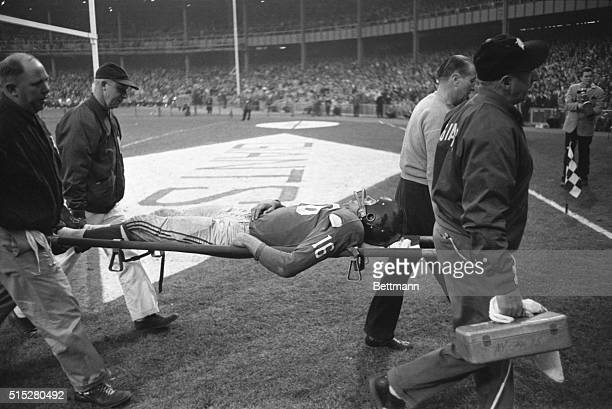 Giants' halfback Frank Gifford is carried off the field on a stretcher after he was injured during the game against the Philadelphia eagles Snagging...