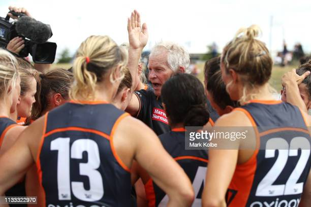 Giants head coach Alan McConnell speaks to the team at three quarter time during the round five AFLW match between the Greater Western Sydney Giants...