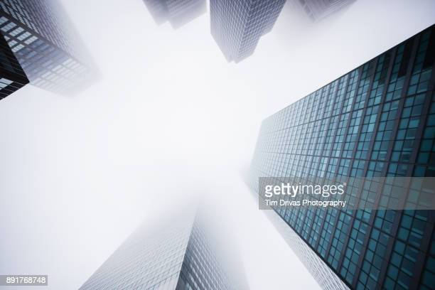 giants in the mist - skyscraper stock pictures, royalty-free photos & images