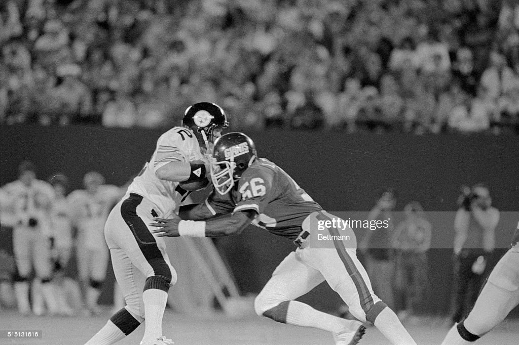 Giant's Lawrence Taylor sacks Steeler's quarterback Terry Bradshaw in the 1st quarter of their exhibition game here at Giants Stadium on August 21st...