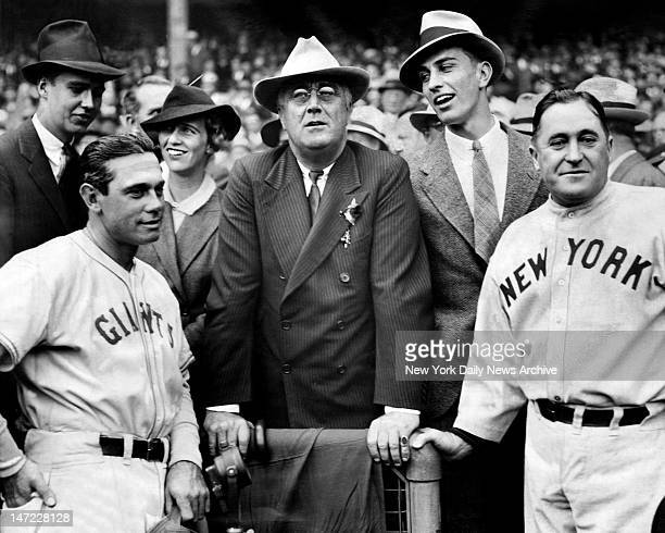 Giants manager Bill Terry and Yankees skipper Joe McCarthy meet with President Roosevelt before Game 2 of 1936 World Series game at the Polo Grounds...