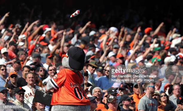 Giants' mascot Lou Seal tosses cracker Jacks to fans during the 7th inning stretch, as the San Francisco Giants went on to beat the Arizona...