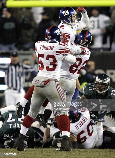 Giants place kicker Jay Feely kicks the game winning field goal in overtime during the game between the New York Giants and the Philadelphia Eagles...