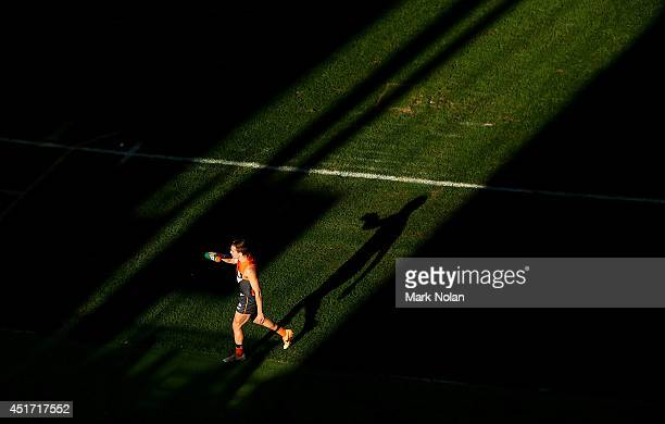 Giants player makes his way to the bench during the round 16 AFL match between the Greater Western Giants and the Adelaide Crows at Spotless Stadium...