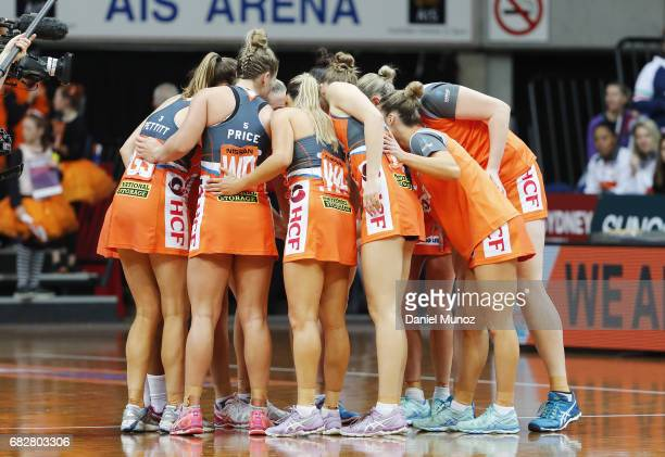 Giants players celebrate after winning the round 12 Super Netball match between the Giants and the Vixens at AIS on May 14 2017 in Canberra Australia