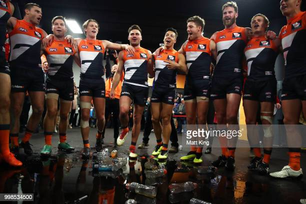 Giants players celebrate victory and sing the club song after the round 17 AFL match between the Greater Western Sydney Giants and the Richmond...
