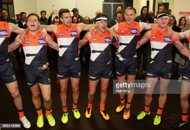 Giants players celebrate victory and sing the club song after the round 22 AFL match between the Greater Western Sydney Giants and the West Coast...