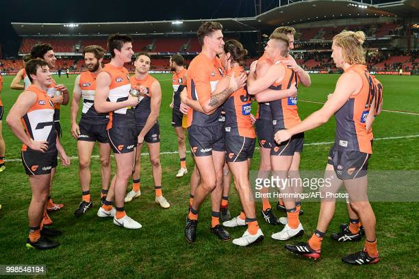 Giants players celebrate victory during the round 17 AFL match between the Greater Western Sydney Giants and the Richmond Tigers at Spotless Stadium...