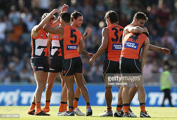Giants players celebrate victory in the round two AFL match between the Greater Western Sydney Giants and the Geelong Cats at Star Track Oval on...