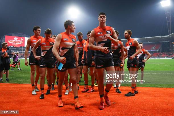 Giants players leave the field during the round 10 AFL match between the Greater Western Sydney Giants and the Essendon Bombers at Spotless Stadium...