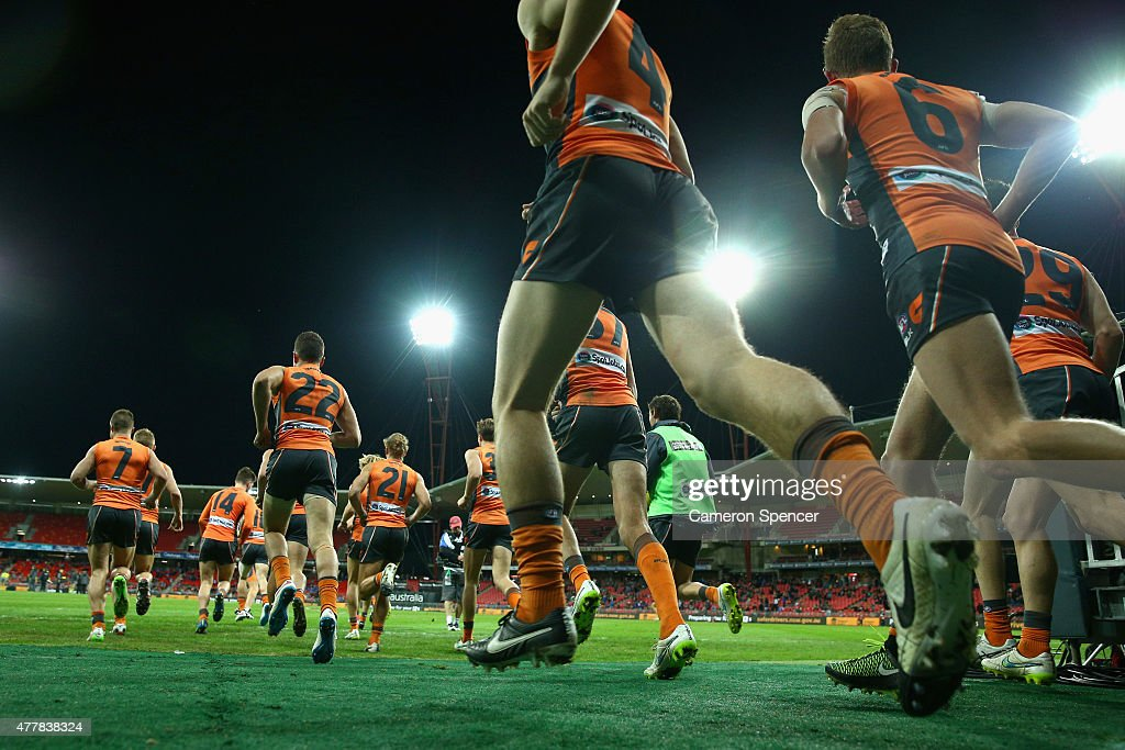 Giants players run onto the field for the second half during the round 12 AFL match between the Greater Western Sydney Giants and the North Melbourne Kangaroos at Spotless Stadium on June 20, 2015 in Sydney, Australia.
