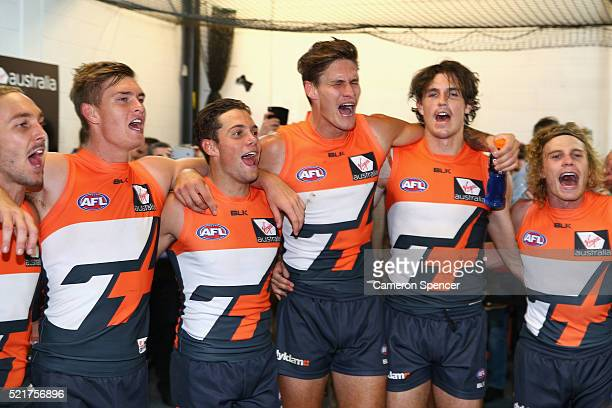 Giants players sing their team song after winning the round four AFL match between the Greater Western Sydney Giants and the Port Adelaide Power at...