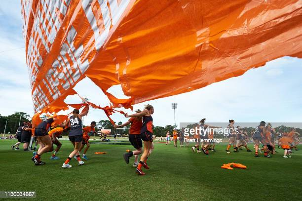 Giants players take to the field during the round three AFLW match between the Greater Western Sydney Giants and the Carlton Blues at Blacktown...