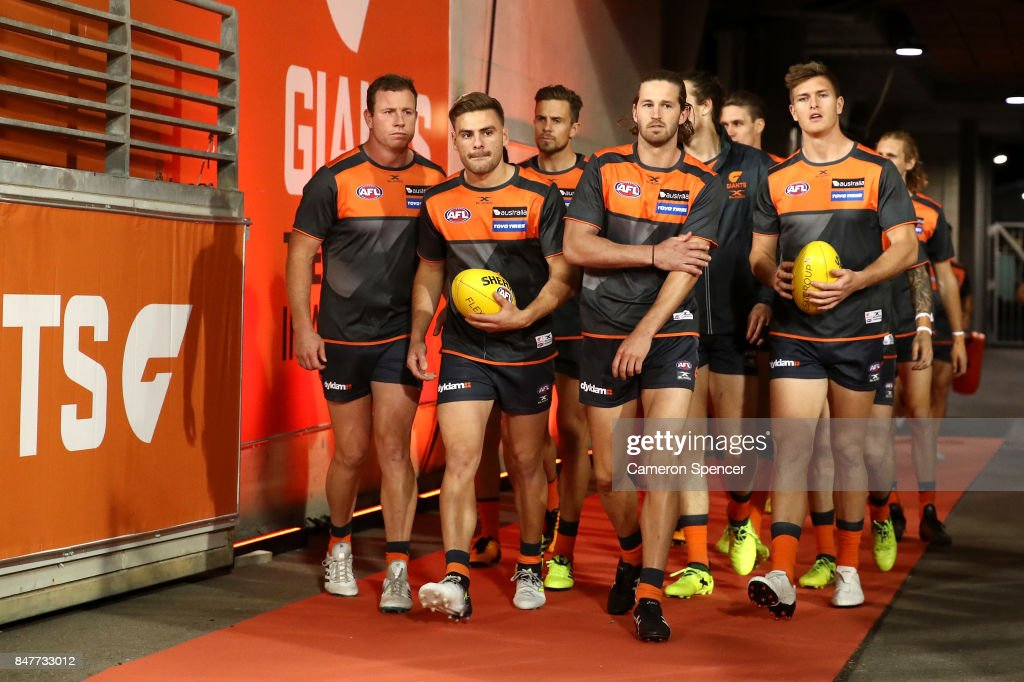 Giants players walk onto the field for warm up during the AFL First Semi Final match between the Greater Western Sydney Giants and the West Coast Eagles at Spotless Stadium on September 16, 2017 in Sydney, Australia.