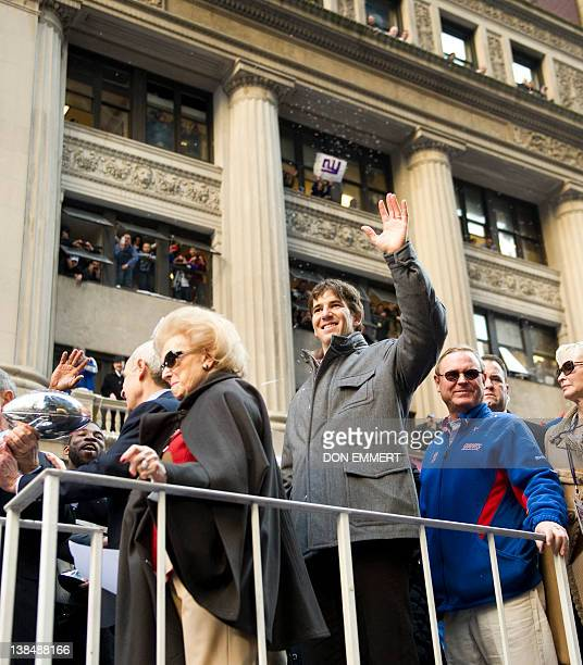 Giants Quarterback Eli Manning and others aboard the VIP truck as it makes it way up Broadway during the New York Giants ticker tape parade February...