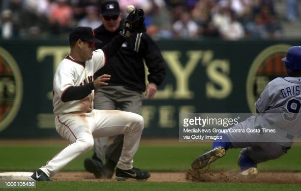 Giants shortstop Ramon Martinez mishandles a throw as Dodger Marquis Grissom slides into second base in the 6th inning of their Major League baseball...