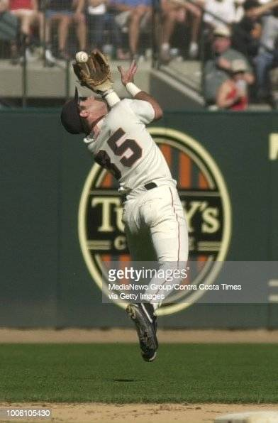 Giants shortstop Rich Aurilia can't catch up to a blooper hit by Padre outfielder Ricky Henderson in the 8th inning at Pac Bell Park on Saturday...