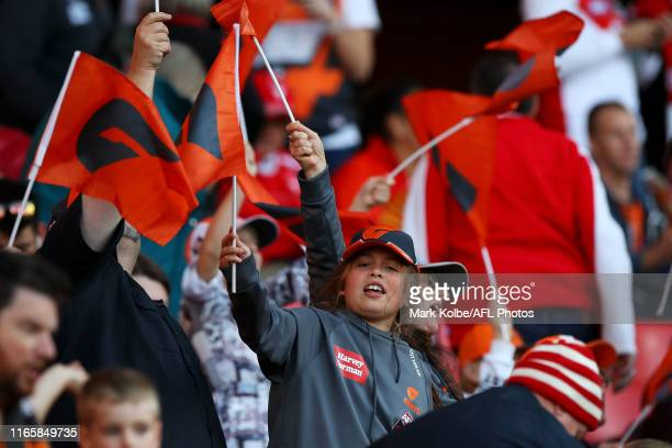 Giants supporters cheer during the round 20 AFL match between the Greater Western Sydney Giants and the Sydney Swans at GIANTS Stadium on August 03,...