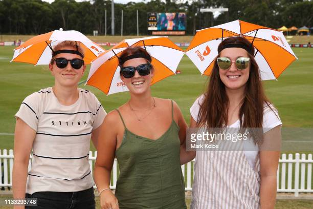 Giants supporters pose before the round five AFLW match between the Greater Western Sydney Giants and the Melbourne Demons at Blacktown International...