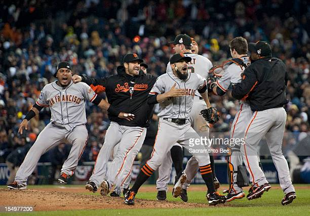 Giants team members celebrate as the San Francisco Giants beat the Detroit Tigers 43 in Game 4 of the World Series at Comerica Park in Detroit...