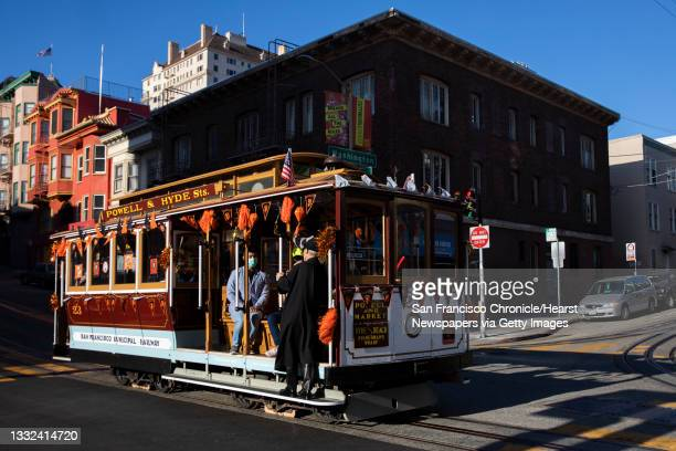 August 2: A Giants themed cable car makes its way up Powell Street as cars resume service for the first time since the start of the COVID-19 pandemic...