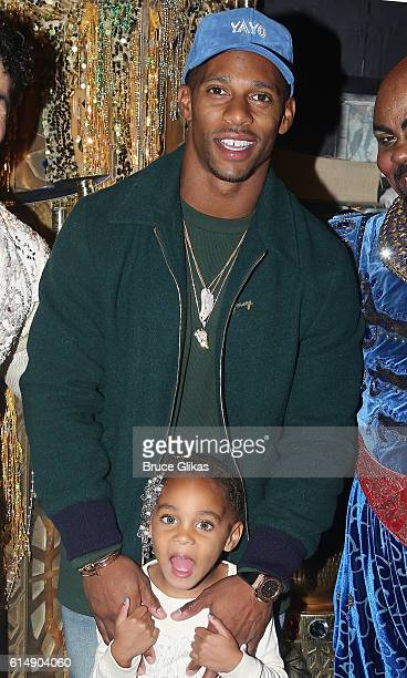 Giants Victor Cruz and daughter Kennedy Cruz pose backstage at Disney's Aladdin on Broadway at The New Amsterdam Theatre on October 15 2016 in New...