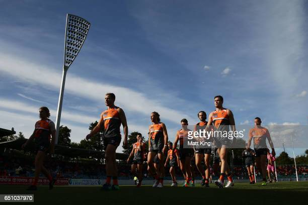 Giants walk from the field after warm up before the JLT Community Series AFL match between the Greater Western Sydney Giants and the North Melbourne...