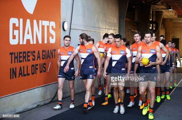 Giants walk through the race during the round 22 AFL match between the Greater Western Sydney Giants and the West Coast Eagles at Spotless Stadium on...