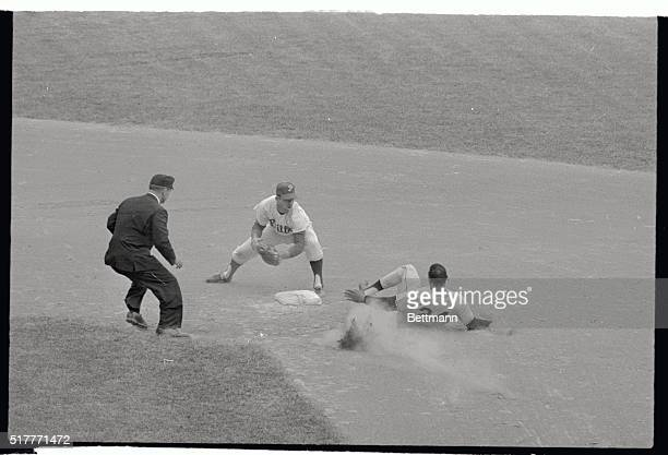 Giant's Willie Mays is out in a cloud of dust here as he tried to stretch a hit to Phillies leftfielder Wes Covington into a double in the eighth...