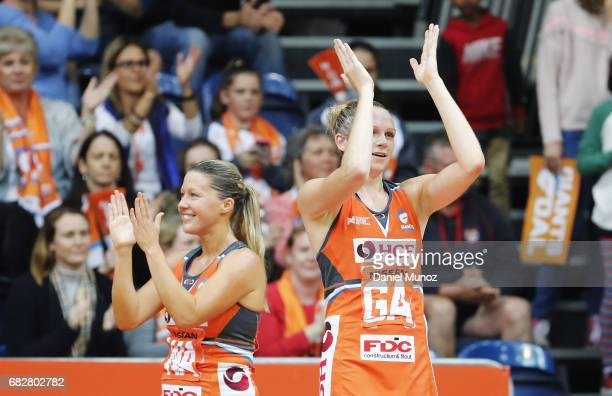 Giants wing attack Sarah Wall and goal attack Jo Harten greet the crowd after winning the round 12 Super Netball match between the Giants and the...
