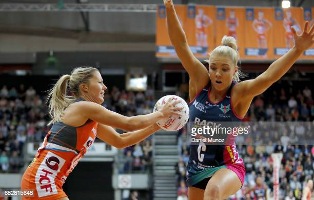 Giants wing attack Sarah Wall evades Vixens centre Kate Moloney during the round 12 Super Netball match between the Giants and the Vixens at AIS on...