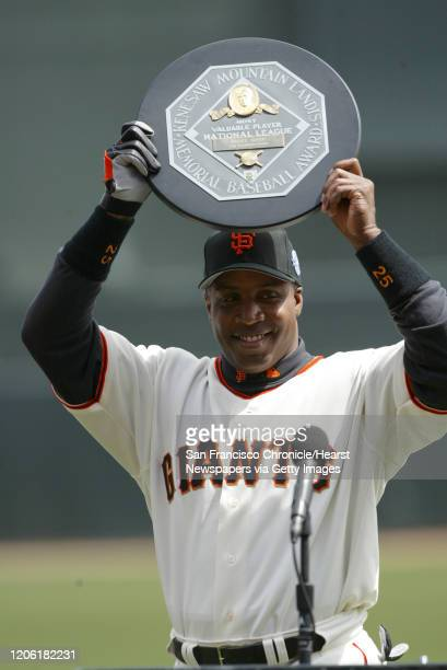 Giants_084_df.JPG ;Barry Bonds holds up his MVP award in a ceremony before the home opener. Barry Bonds hits career homerun to tie his godfather,...