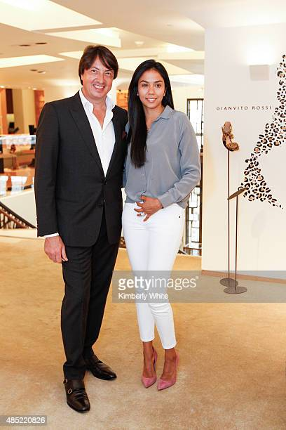 Gianvito Rossi and Carmen Hanson pose for a photograph at Barneys New York hosts an afternoon of shopping with designer Gianvito Rossion August 25...