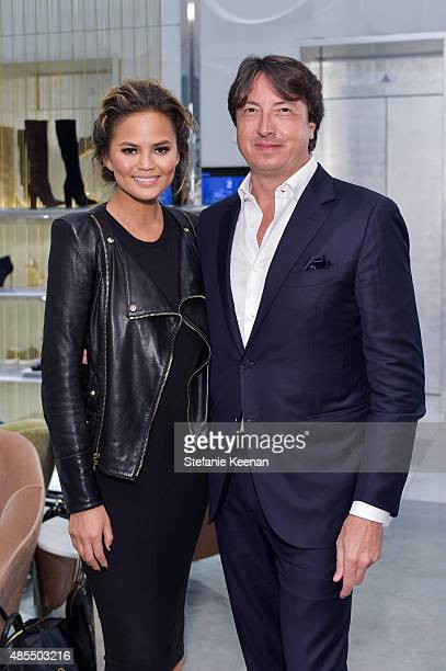 Gianvito Rossi and Chrissy Teigen attends Barneys New York Fetes Shoe Designer Gianvito Rossi at Barneys New York Beverly Hills on August 27 2015 in...