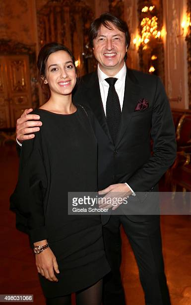 Gianvito Rossi and his daughter Sofia Rossi pose during the mytheresacom X Gianvito Rossi dinner at St Emmeram Castle on November 19 2015 in...