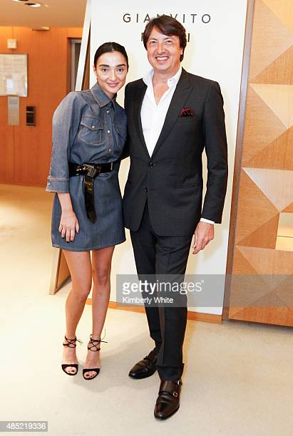 Gianvito Rossi and Olga Dzilikhova pose for a photograph at Barneys New York hosts an afternoon of shopping with designer Gianvito Rossion August 25...