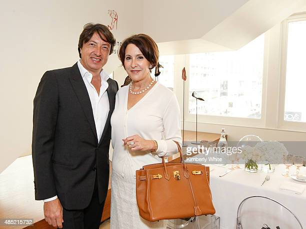 Gianvito Rossi and Susan Ahterton at the Susan Atherton and Barneys New York private luncheon for Gianvito Rossi on August 25 2015 in San Francisco...