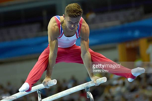 Giarnni Regini Moran of Great Britain in action during the Parallel Bars Competition of the Boys All-Round Individual Artistic Gymnastic Final during...