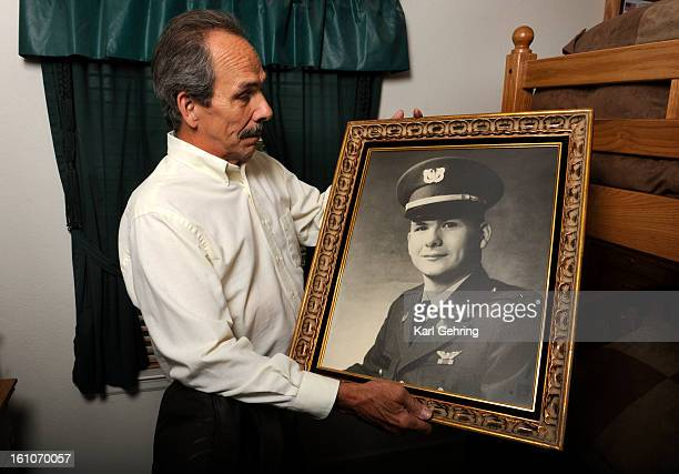CD02REMAINS Gib McKain posed with a portrait of his older brother Bobby McKain who died after his AH1 Cobra attack helicopter was shot down May 3...
